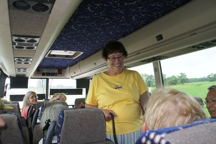 Tour coordinator Molly Schneider socializing on the bus