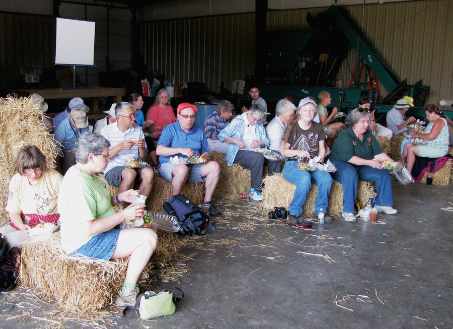 Tour group enjoying a delicious box lunch in the barn