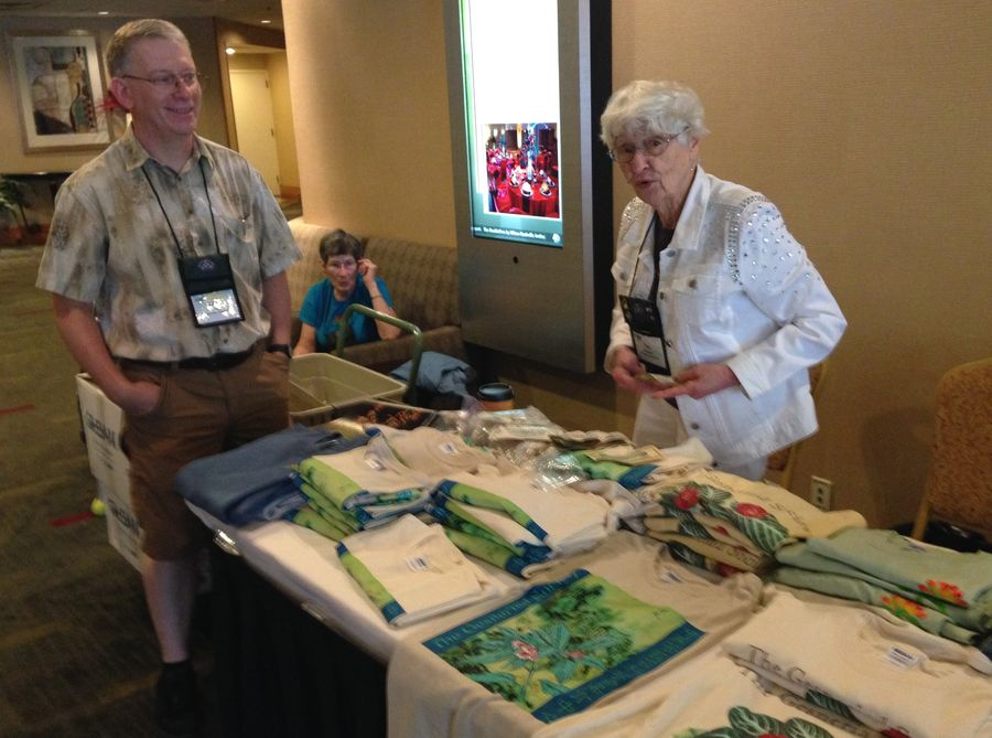 Fay Wagman reviewing the promotional items table with Brad Walker