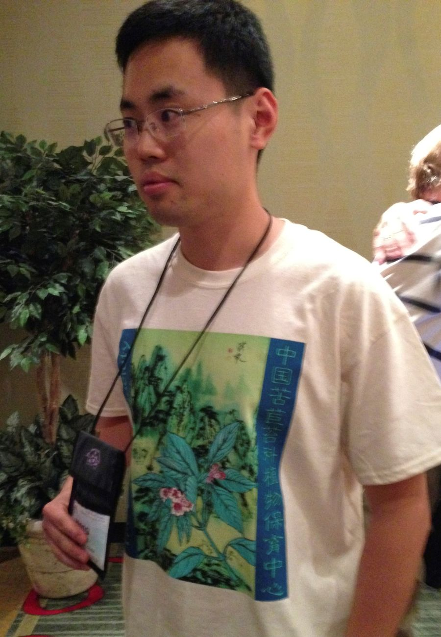 Hong Xin wearing the Society's new tee-shirt he helped design featuring <i>Hemiboea roseoalba</i>