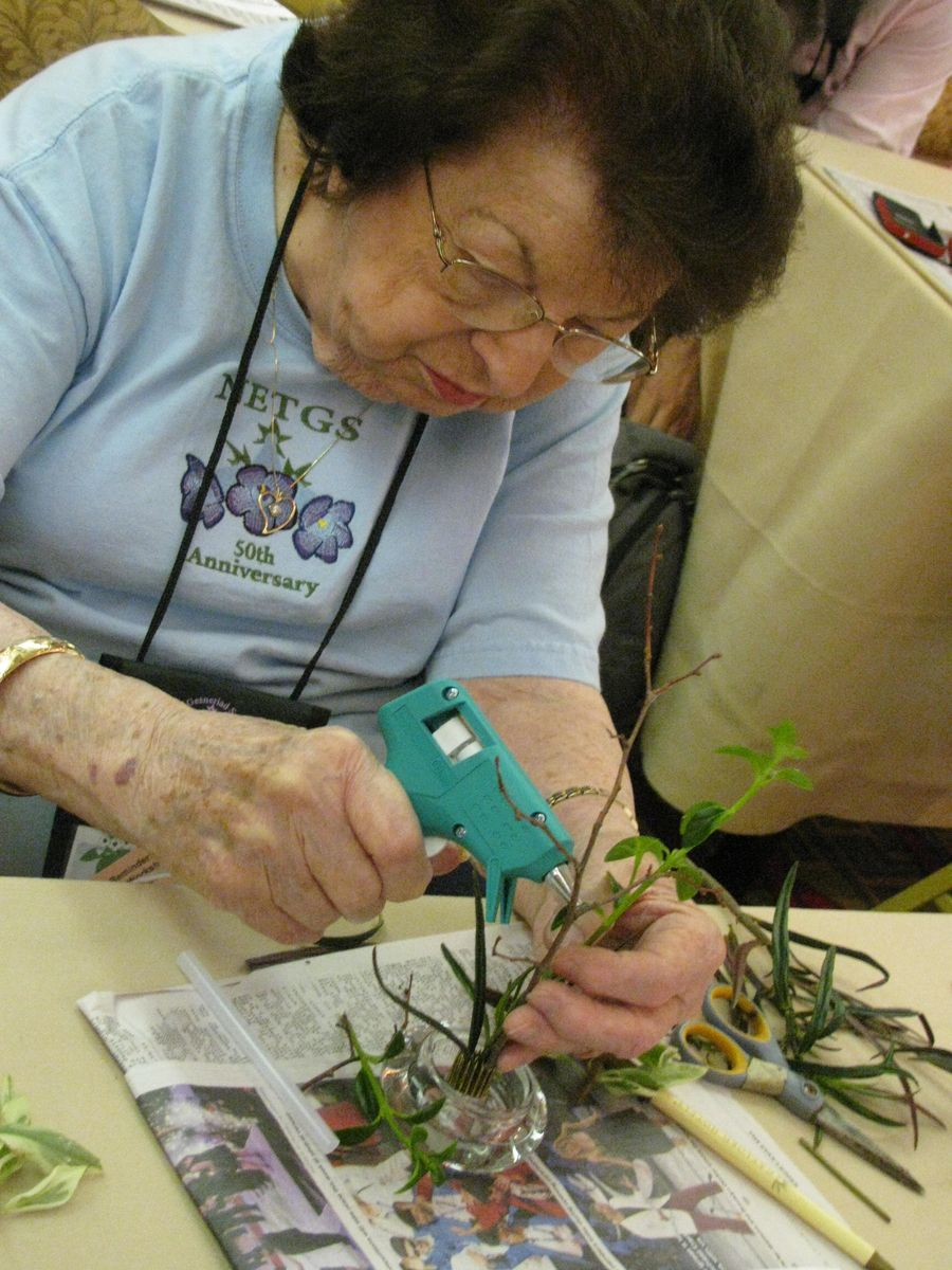 Mary Bozoian using a glue-gun to hold her design in place