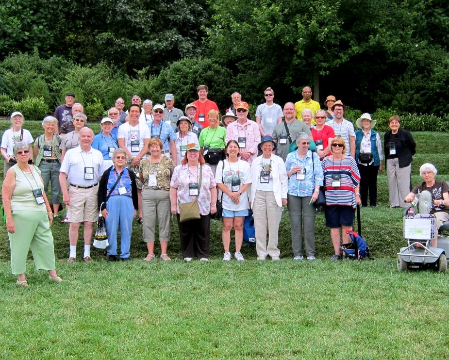The group gathers outside the Conservatory