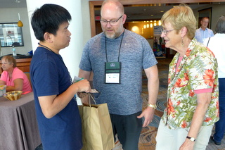 Greeting old friends and new at Registration: Qiu Zhi-Jing, Winston Goretsky, and Betsy Gottshall