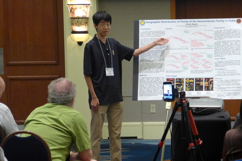 "Hiroki Nagao presenting his poster ""Geographic Distribution of Gesneriaceae in Cuba"""