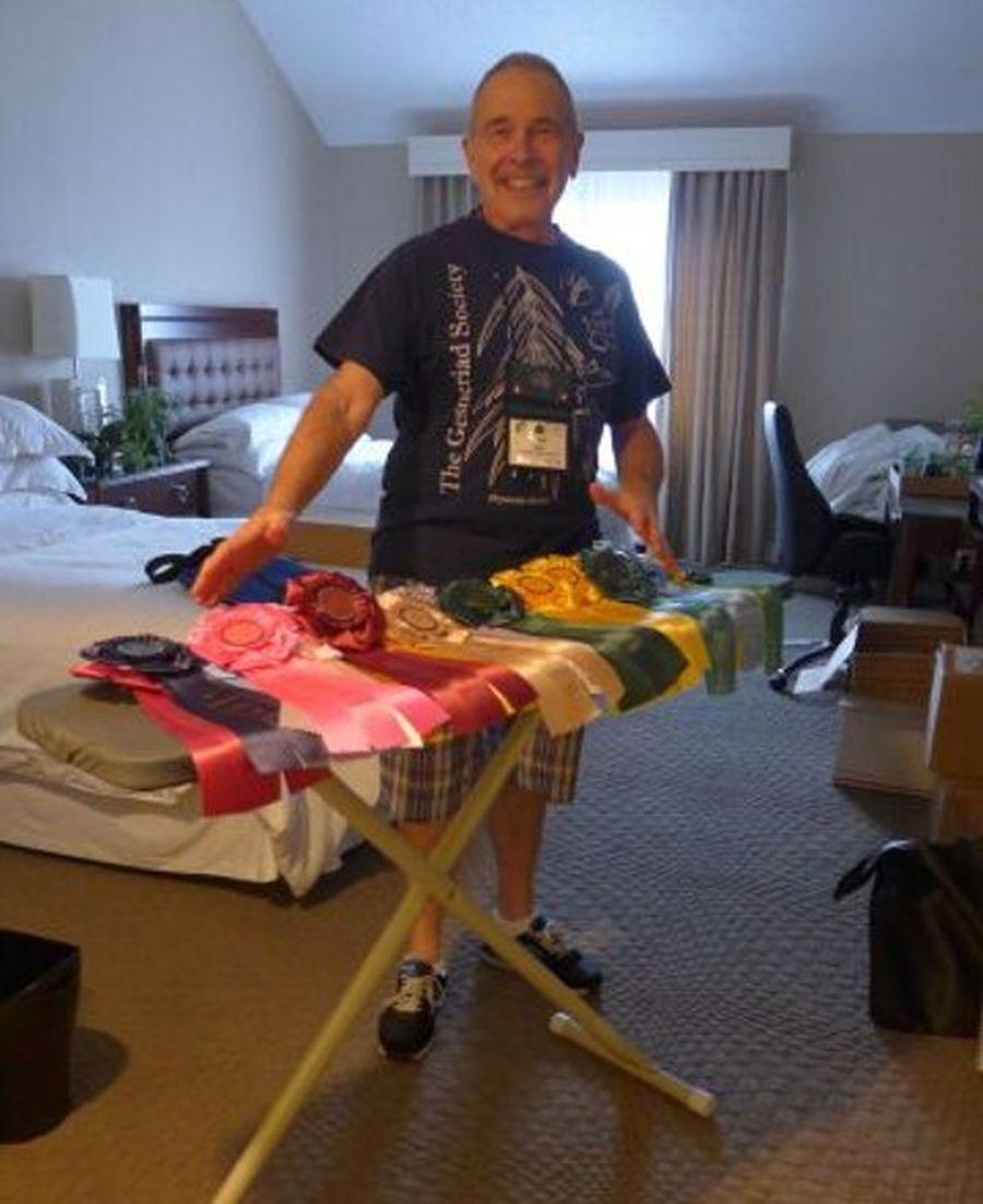Awards Chair Paul Susi ironing special award ribbons