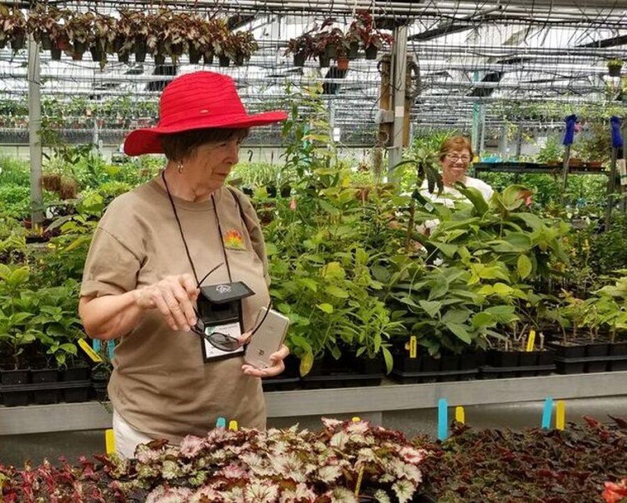 Eileen McGrath and Mollie Schneider enjoying more plants