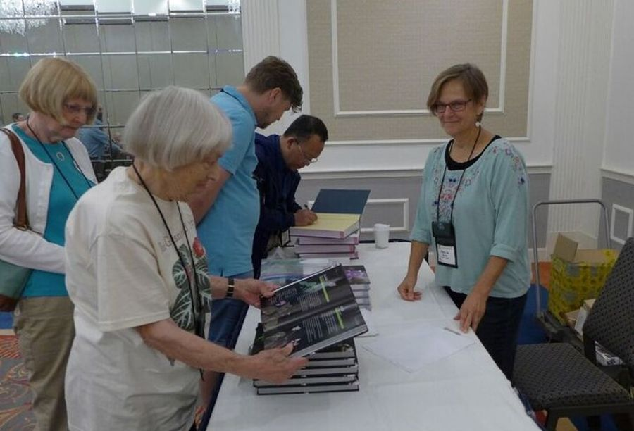 Mary Jo Modica helping with the China book sales